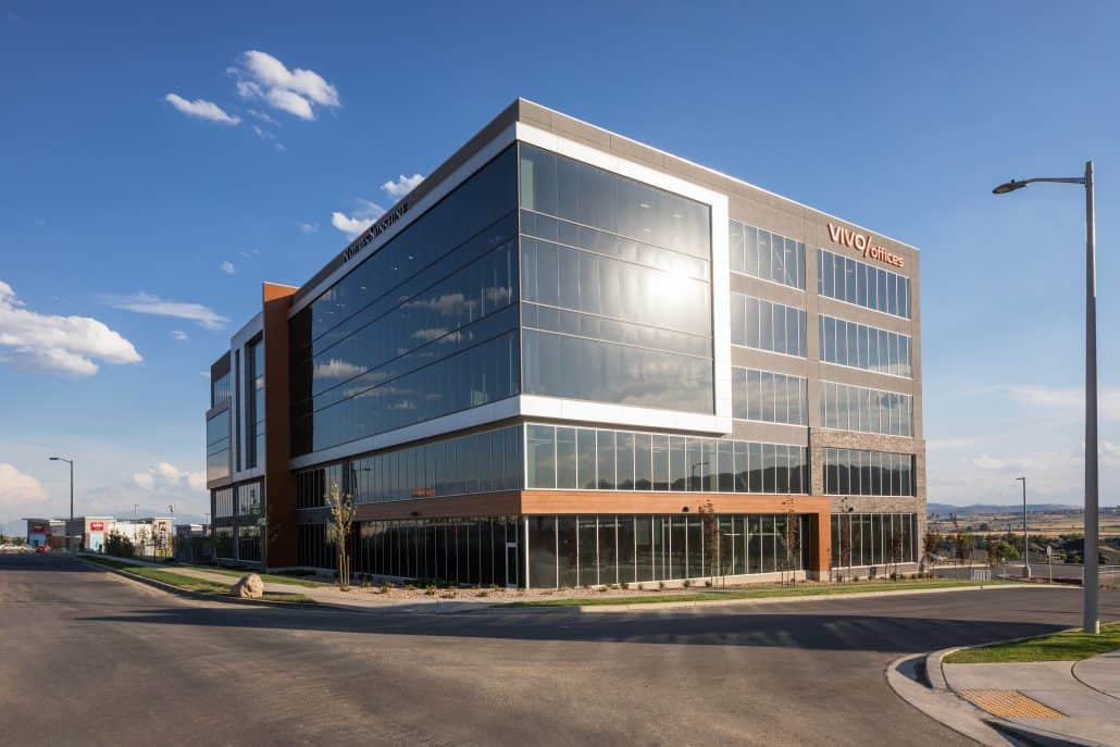 Commercial Properties for lease: Side of Lone Peak office building in sunny weather