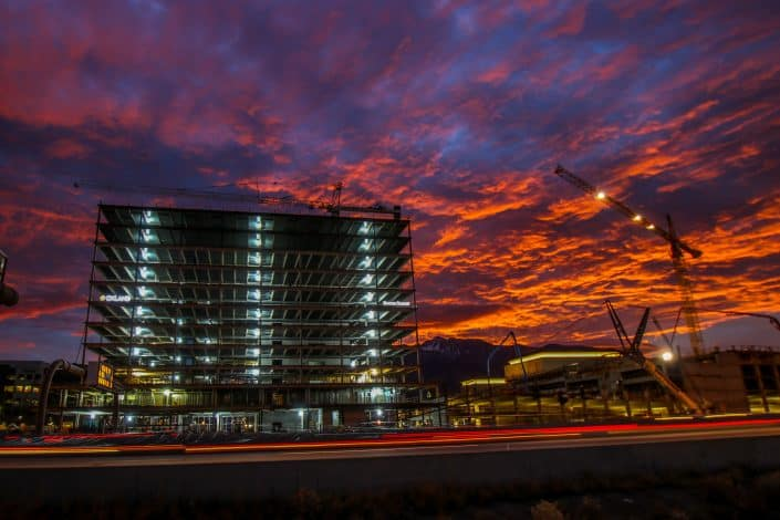 Front of Mountain America Credit Union headquarters in beautiful sunset
